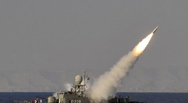 Footage apparently showing an Iranian navy vessel launching a missile during a drill (AP/ISNA)
