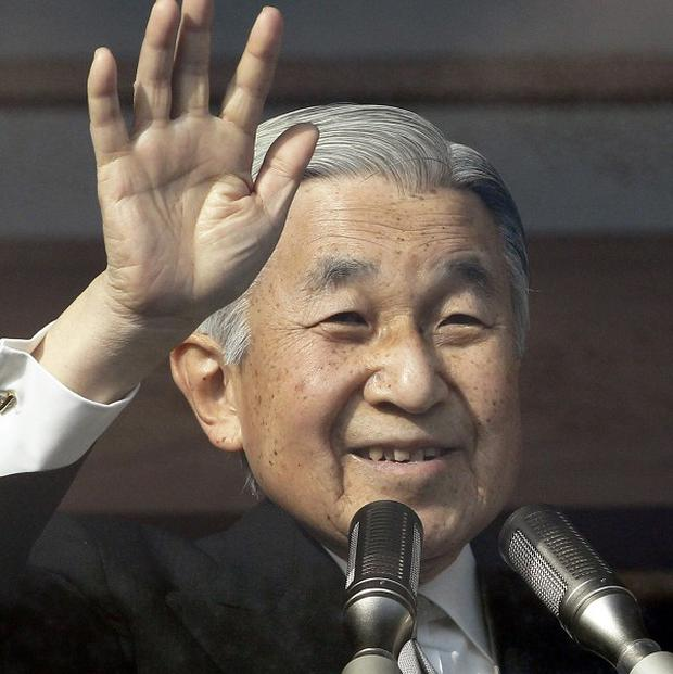 Japan's Emperor Akihito waves to well-wishers from the palace balcony at the Imperial Palace in Tokyo (AP)
