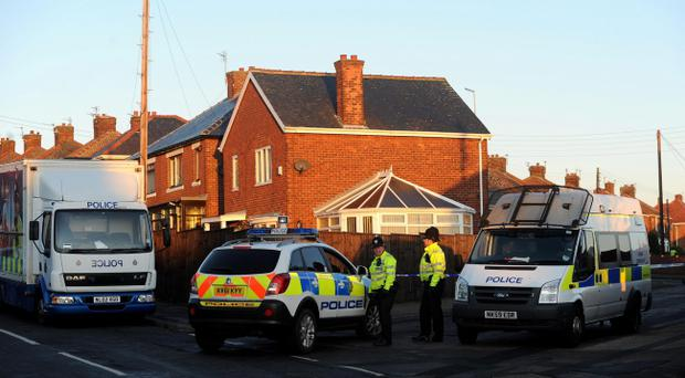 A general view of police at the scene on Greenside Avenue in Peterlee where four people have been found dead in a house following a suspected firearms incident, police said today