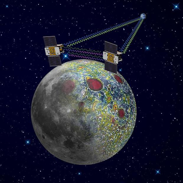 An artist rendering shows the twin Grail spacecraft mapping the lunar gravity field (AP/Nasa, Jet Propulsion Laboratory)