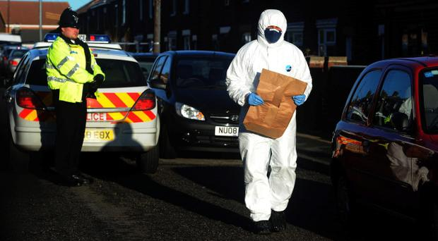 A general view of forensic police officers at the scene on Greenside Avenue in Peterlee where four people have been found dead in a house following a suspected firearms incident, police said today. PRESS ASSOCIATION Photo. Picture date: Monday January 2, 2012. The bodies of one man and three females were found inside a semi-detached house in Greenside Avenue, Peterlee, after officers were alerted shortly before 11.45pm yesterday, Durham Police said