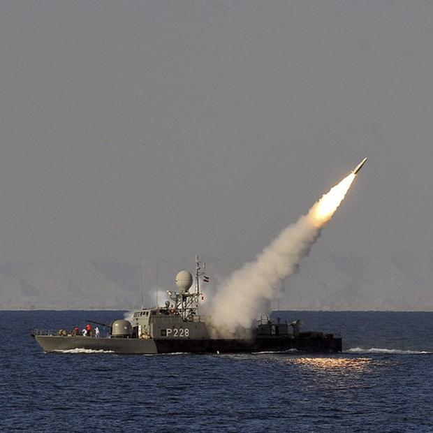 An Iranian navy vessel launches a missile during a drill at sea (AP/ISNA,Amir Kholousi)