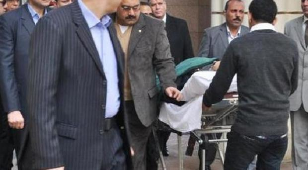 Former Egyptian president Hosni Mubarak is wheeled into a court in Cairo (AP)