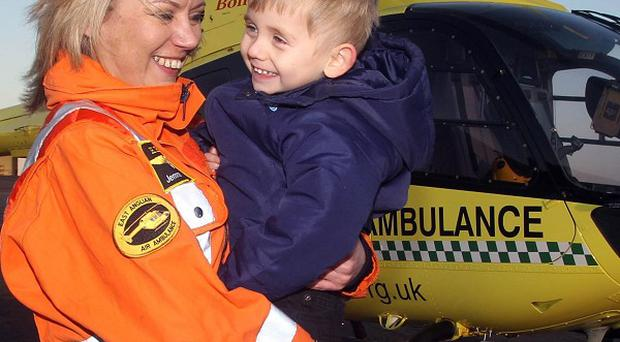 Helicopter Paramedic Jemma Varela, 31, with three-year-old Kai Clark, who died for six minutes after suffering a cardiac arrest
