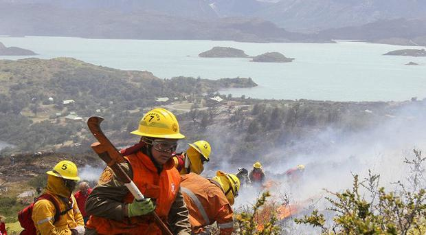 Firefighters in Chile are coping with a spate of forest fires (AP)