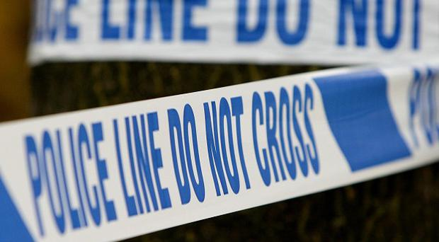 The deaths of a man and a woman whose bodies were discovered inside a house are being treated as suspicious