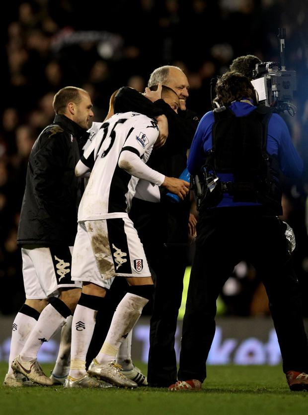 LONDON, ENGLAND - JANUARY 02: Scorer of the matchwinning goal Bobby Zamora of Fulham and his manager Martin Jol walk off the pitch following their team's 2-1 victory during the Barclays Premier League match between Fulham and Arsenal at Craven Cottage on January 2, 2012 in London, England. (Photo by Clive Rose/Getty Images)