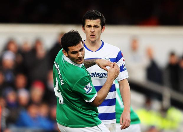 LONDON, ENGLAND - JANUARY 02: Joey Barton (R) of Queens Park Rangers confronts Bradley Johnson (L) of Norwich City and is sent off during the Barclays Premier League match between Queens Park Rangers and Norwich City at Loftus Road on January 2, 2012 in London, England. (Photo by Scott Heavey/Getty Images)