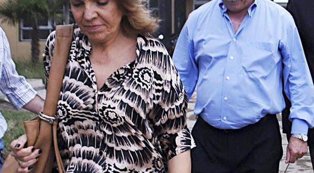 Susana Fredoz is followed by her husband Carlos Soria, governor of the southern Argentine province of Rio Negro (AP)