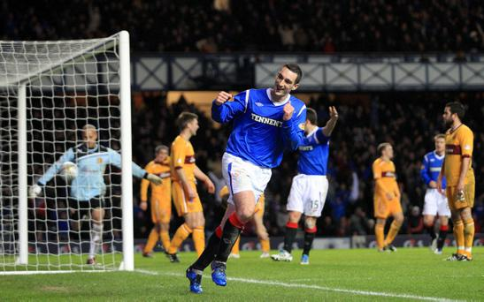 Lee Wallace celebrates after Stephen Craigan's own goal puts Rangers 3-0 up against Motherwell at Ibrox yesterday