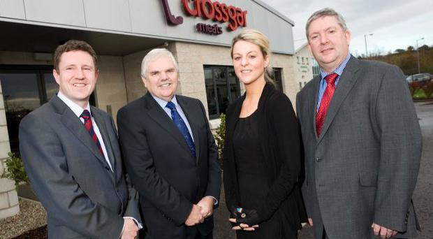 Dr Bill McGinnis (second left), Northern Ireland adviser on Employment and Skills, pictured with (left), Michael Morrissey, managing director, Crossgar Foodservice, Ciara McGreevy, HR manager, and Terry Casement, financial director, Crossgar Foodservice
