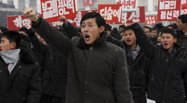 North Koreans gather in Pyongyang to voice their support for their country's policies and new leader Kim Jong Un (AP)