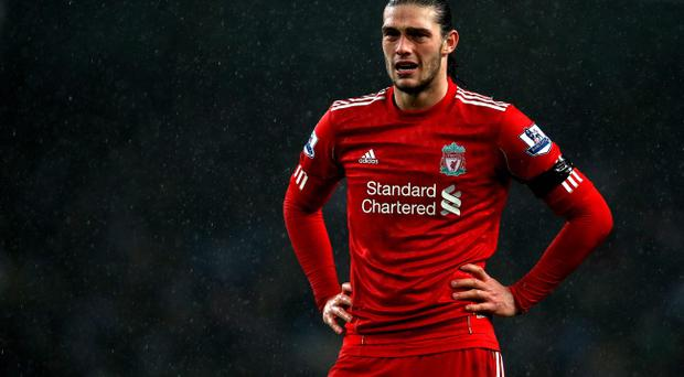 MANCHESTER, ENGLAND - JANUARY 03: Andy Carroll of Liverpool looks dejected during the Barclays Premier League match between Manchester City and Liverpool at the Etihad Stadium on January 3, 2012 in Manchester, England. (Photo by Clive Brunskill/Getty Images)