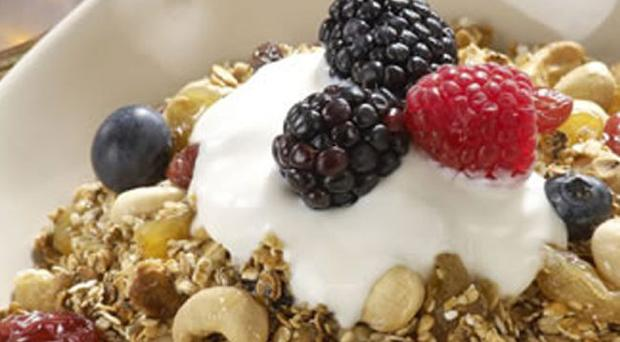 Home made granola with maple flavoured yogurt & fresh berries