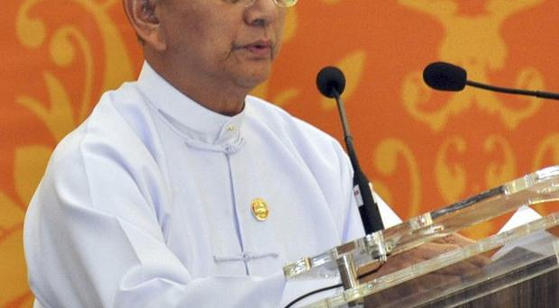 Burma's president Thein Sein has said the power of big nations threatens the sovereignty of smaller ones (AP)