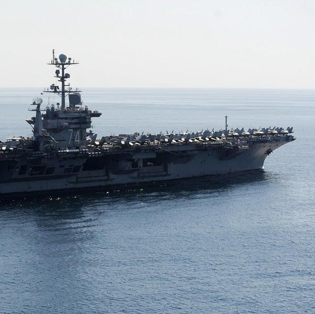 The US aircraft carrier USS John C Stennis transits the Straits of Hormuz last November (AP)