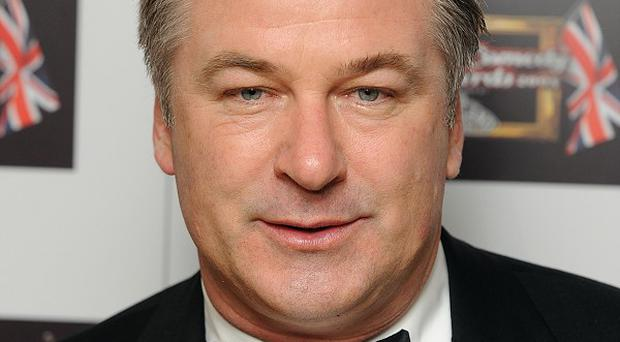 Alec Baldwin was removed from a New York-bound plane for refusing to turn off his mobile phone