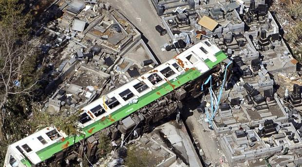 A wrecked train lies among other debris after the Japanese tsunami and earthquake which helped make 2011 a record year for insurance pay-outs (AP)