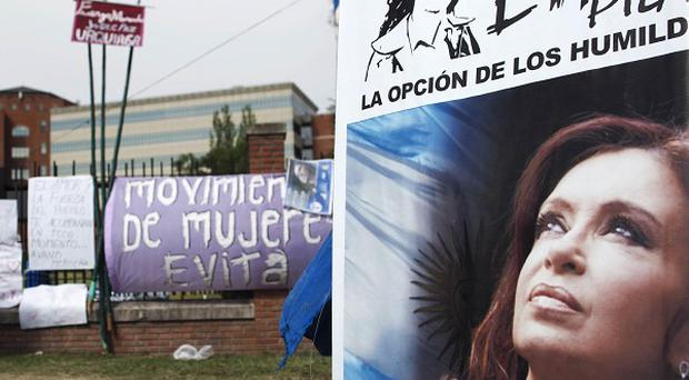 A poster of Argentina's President Cristina Fernandez hung by a supporter outside the hospital where she had successful cancer surgery (AP)