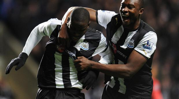 Newcastle United's Demba Ba (left) celebrates his goal during the Barclays Premier League match at the Sport Direct Arena Park, Newcastle