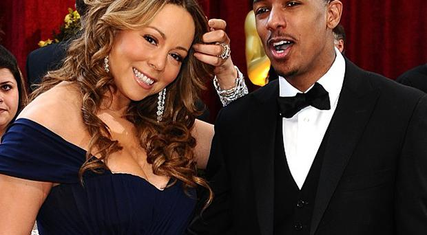 Mariah Carey asked fans to pray for husband Nick Cannon, who has mild kidney failure