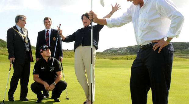 Coleraine Mayor Maurice Bradley, Philip Tweedie, Captain of Royal Portrush Golf Club, Former US Open champion Graeme McDowell, Tourism Minister Arlene Foster and Open winner Darren Clarke at Royal Portrush. Ms Foster confirmed the Northern Ireland Executive would provide financial assistance to help bring a major tournament to the course