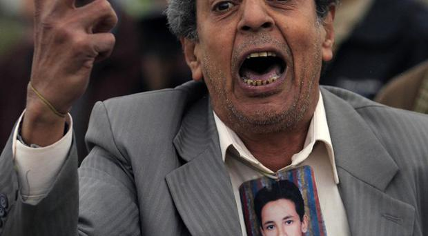 Anti-Mubarak protesters demonstrate outside the court in Egypt (AP)