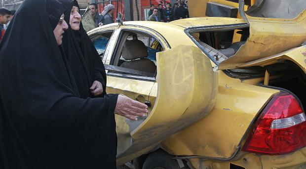 A wave of explosions struck two Shiite neighbourhoods in Baghdad, Iraq (AP)