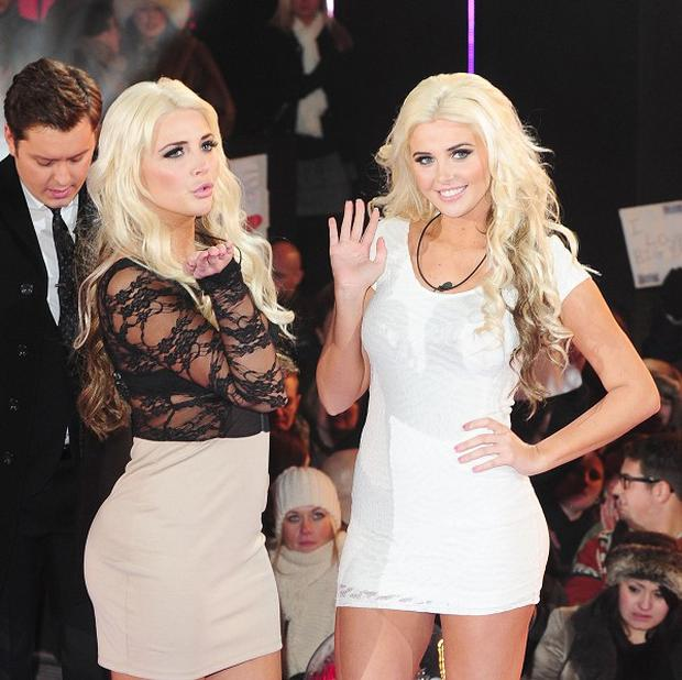 Kristina, left, and Karissa Shannon make their entrance to the Celebrity Big Brother house