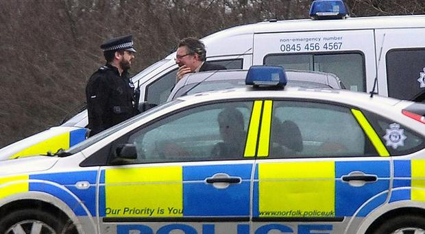 Police attend the scene following the discovery of human remains on the Sandringham estate in Norfolk