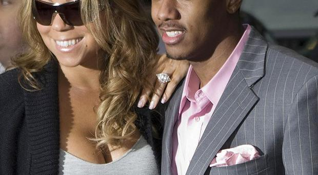 Mariah Carey has been by Nick Cannon's bedside