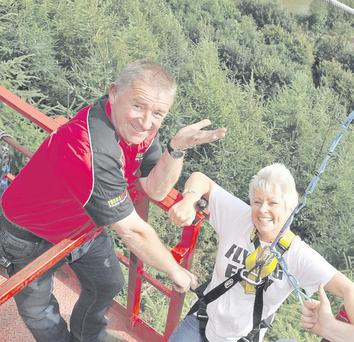 Benny O'Hanlon, who believes in getting the most from life – for himself and his customers, helps Pamela Ballantine on the zip line