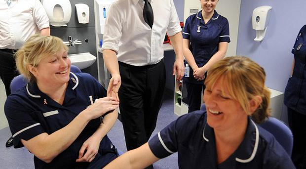 David Cameron and Andrew Lansley, left, meet nurses during a visit to the Royal Salford Hospital in Manchester
