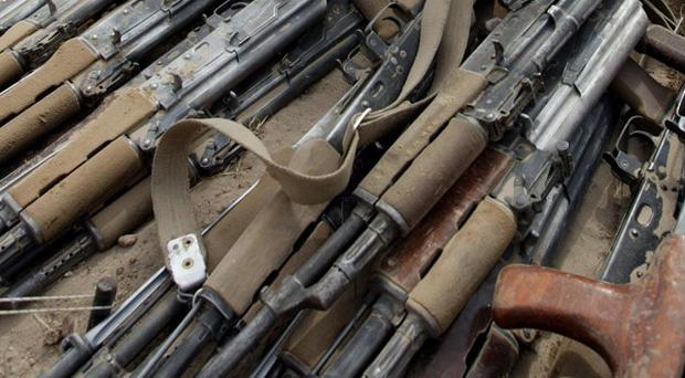 Two British private security contractors have been arrested in Afghanistan on suspicion of smuggling AK-47 rifles