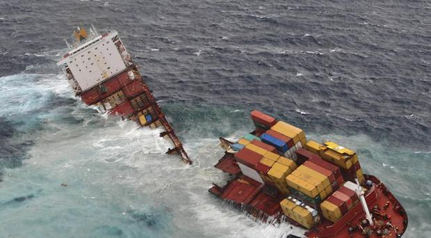 Stranded cargo ship Rena has broken in two off the coast of New Zealand amid severe storms (Maritime New Zealand/AP)
