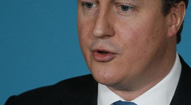 Prime Minister David Cameron said shareholders will be given a binding vote on executive salaries