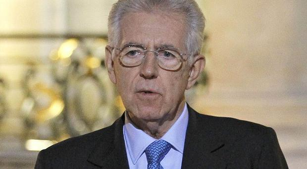Italian PM Mario Monti has warned that no European nation is strong enough to ride out the continent's debt crisis alone (AP)