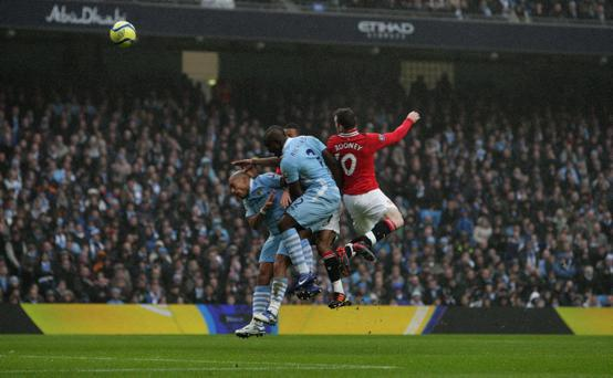 Manchester United's Wayne Rooney (right) scores his sides first goal of the game during the FA Cup, Third Round match at the Etihad Stadium, Manchester
