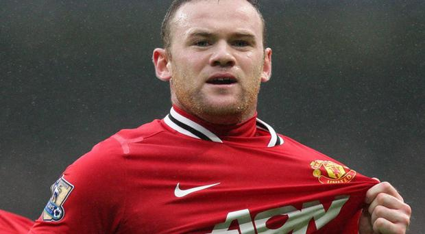 Manchester United's Wayne Rooney celebrates scoring his side's first goal of the game