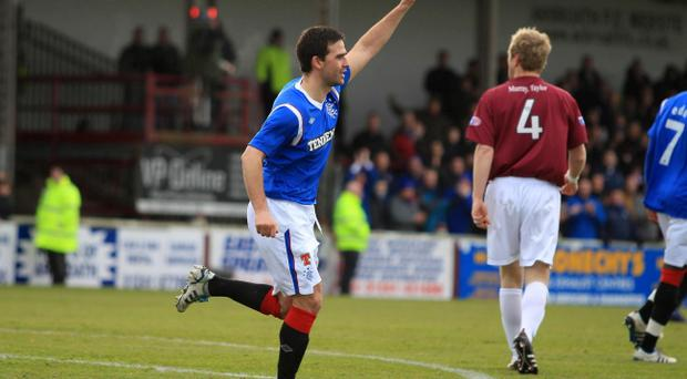 Rangers' David Healy celebrates scoring the first goal during the Scottish Cup, Fourth Round match at Gayfield Park, Arbroath