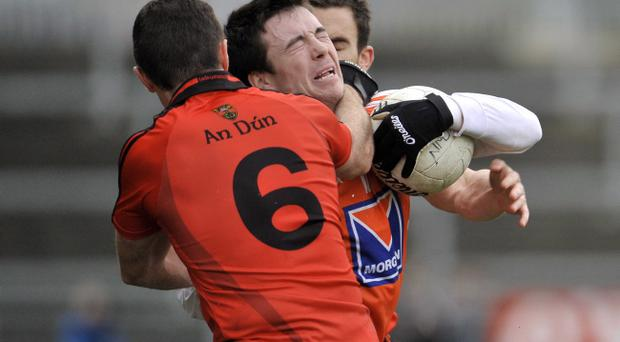 Armagh's Aidan Forker is tackled by Down's Liam Doyle during yesterday's Dr McKenna Cup game at Pairc Esler in Newry
