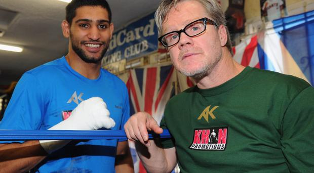Trainer Freddie Roach (right) says he knows the Khan 'mystery man'