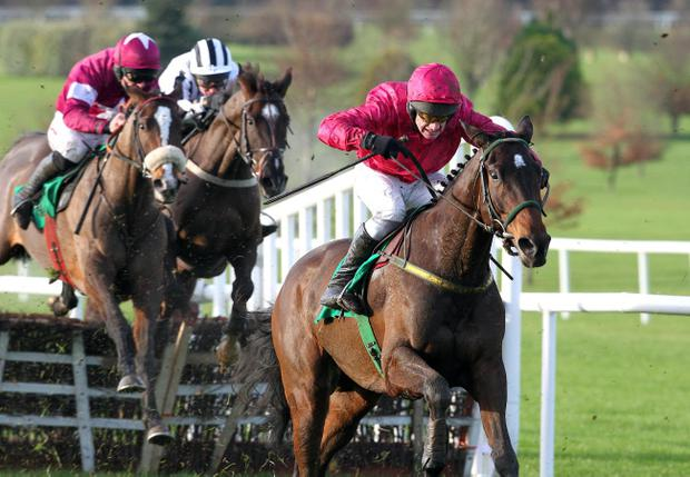 Monksland (right), with Paul Carberry on board, won the feature race at Naas yesterday