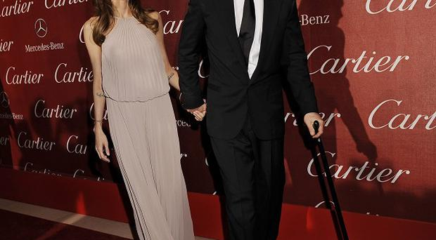 Brad Pitt's partner Angelina Jolie says he likes his cane
