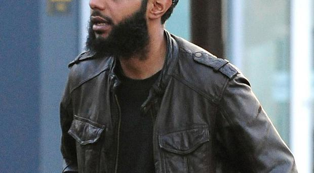 Kabir Ahmed, 28, arrives at Derby Crown Court where he and four others deny stirring up hatred on the grounds of sexual orientation