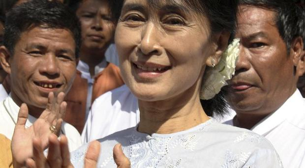 Democracy leader Aung San Suu Kyi is to run for a parliamentary seat in Burma's by-elections (AP)