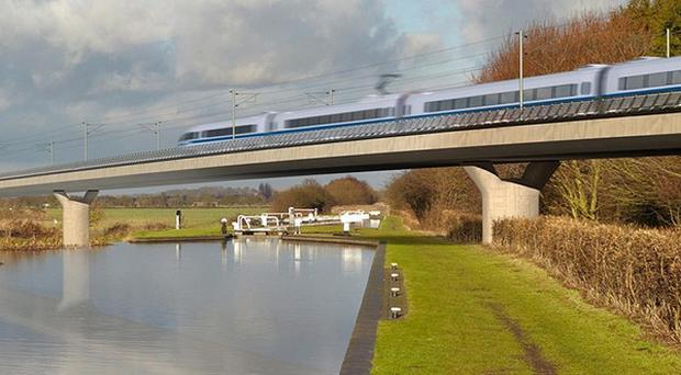 An artist impression shows the controversial HS2 high-speed railway pass over the Birmingham and Fazeley viaduct