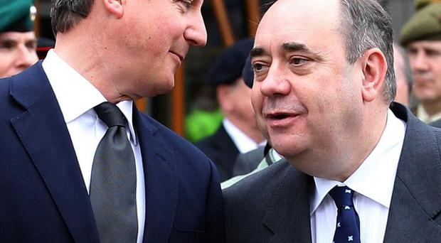 David Cameron and Alex Salmond disagree on when a Scottish independence referendum should be held