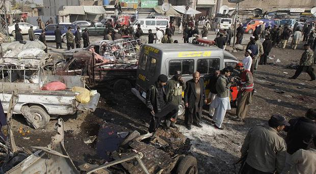 Security forces at the scene of the deadly blast in Khyber near Peshawar, Pakistan (AP)