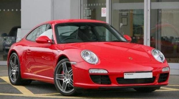 <b>2009 Porsche 911 Carrera S Coupe. Price: £54,950 </b><br/> 19 inch Turbo wheels, forged, two-tone, Extended navigation module for PCM 3.0, Cruise control, Heated seats, Windscreen with grey top tint, ParkAssist (parking aid rear), 7-speed double clutch transmission (Porsche Doppelkupplung -, Heated steering wheel, Rear wiper, Standard seat, Universal audio interface, CDC-4 six disc CD/DVD autochanger, Telephone module<br/>